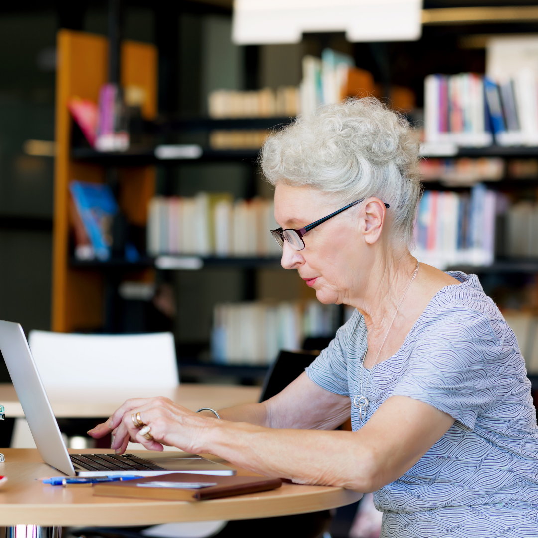 Older lady at notebook computer, learning