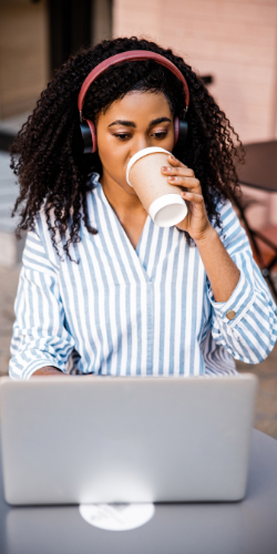 Woman drinking coffee and feeling happy